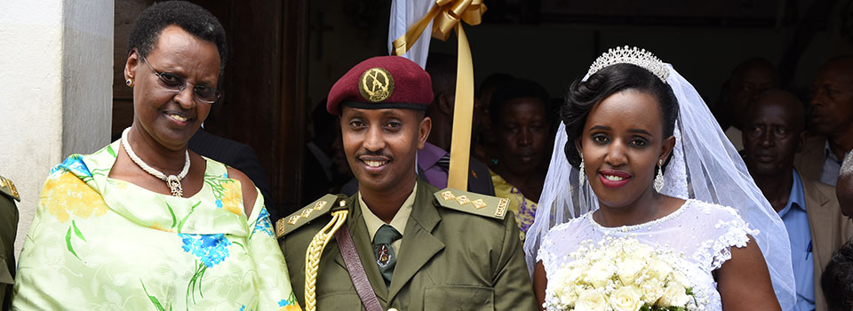 First Lady and Minister of Education and Sports Mrs Janet Museveni with newlywed Captain Reuben and Christine Kuribakanya after they pronounced their vows at All Saints Cathedral Kampala on Saturday. Captain Reuben Kuribakanya is the First Lady's ADC.