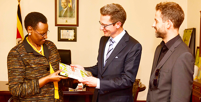 "First Lady and Minister for Education and Sports Janet Museveni presents a book ""Explore Uganda"" to Reinhard Lechner (centre) and Felix Holland  representatives of Lucas- Nuelle at State House Nakasero on Wednesday 15th November 2017."